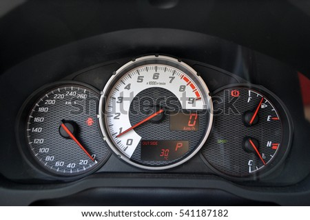 Speedometer and tachometer on the dashboard of a car