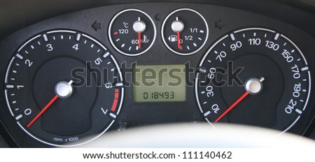 speedometer and tachometer with additional instruments - stock photo