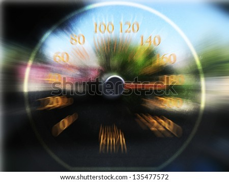 Speedometer scoring high speed in a fast motion blur - stock photo