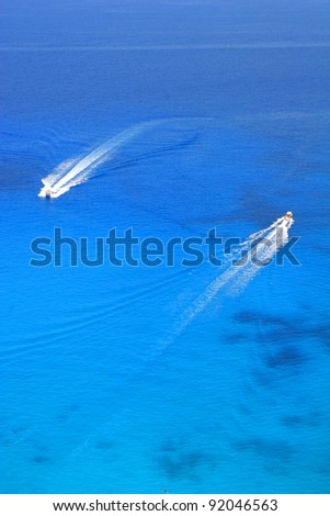 Speeds boat on the azure sea - stock photo