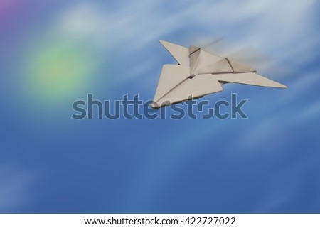 SPEEDY PAPER JET PLANE  IN THE SKY (SPACE FOR ADD TEXT) - stock photo