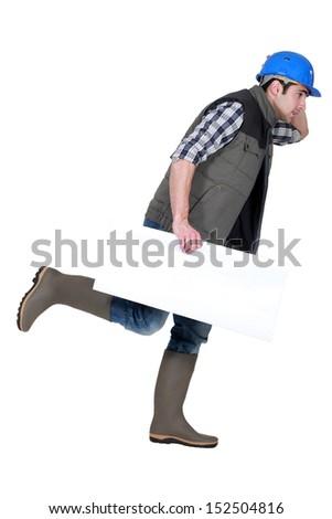 Speedy tradesman holding a blank sign - stock photo