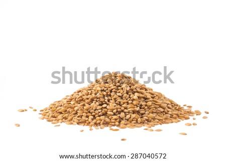 Spelt heap isolated on white background - stock photo