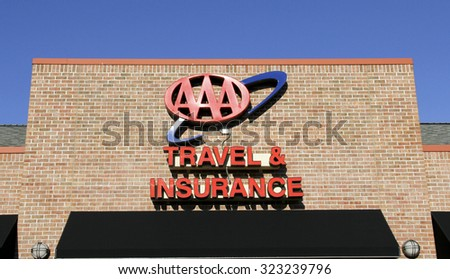 SPENCER , WISCONSIN, OCTOBER, 3  2015    AAA Travel & Insurance Sign  AAA is a federation of motor clubs throughout North America and was founded in 1902 - stock photo