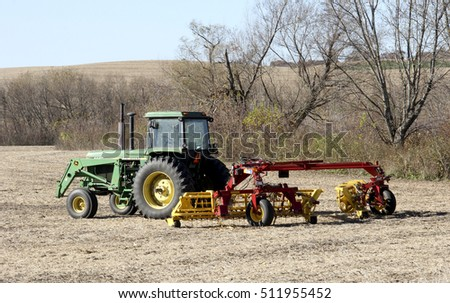 Spencer, Wisconsin - October, 28, 2016   John Deere tractor working a field in the early harvest season