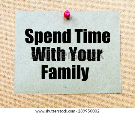 Spend Time With Your Family written on paper note pinned with red thumbtack on wooden board. Motivation conceptual Image - stock photo