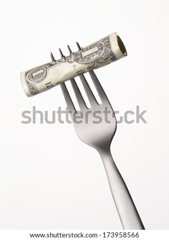 spending money concept,One dollar bill on a fork on white background. - stock photo