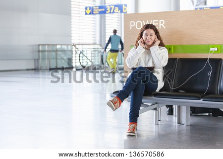 Spending time and charging devices in airport lounge - stock photo