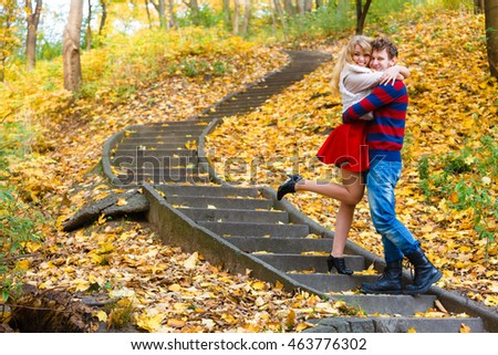 Spending time with loved ones. Romantic dates in autumnal park. Affection and feelings. Frendship and love. Young couple meet at park having fun on romantic date. Man hold woman in arms hug.
