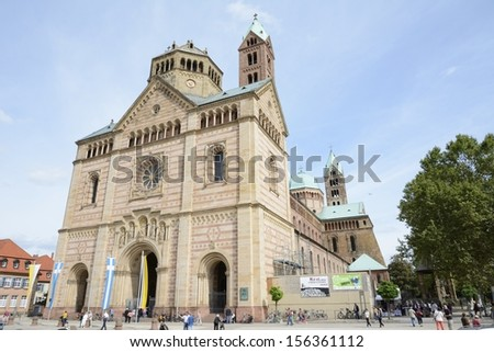 SPEYER, GERMANY - SEPTEMBER 1: Tourists at the cathedral of Speyer, Germany on September 1, 2013. n 1981, the cathedral was added to the UNESCO World Heritage List of culturally important sites.