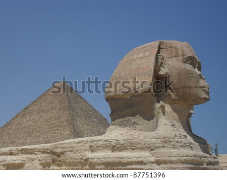 Sphinx and Great Pyramid - stock photo