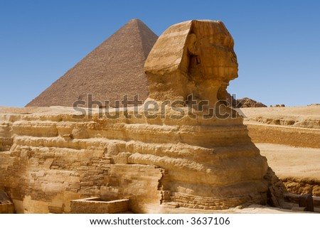 Sphinx and Great Pyramid of Khufu in Giza - stock photo