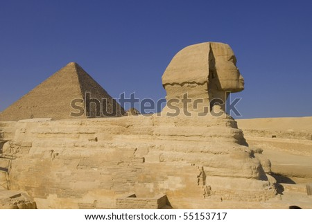 Sphinx and pyramid in Giza, the only one of the Seven Wonders of Ancient world - stock photo