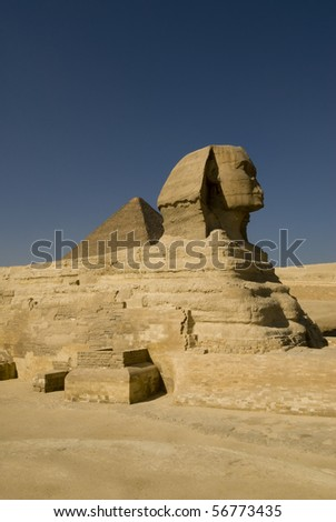 Sphinx and pyramid in Giza, the only one of the Seven Wonders of the Ancient World - stock photo