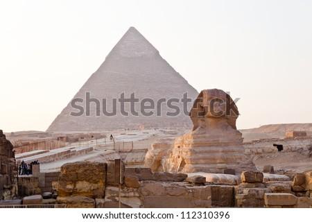 sphinx and pyramid of giza - stock photo