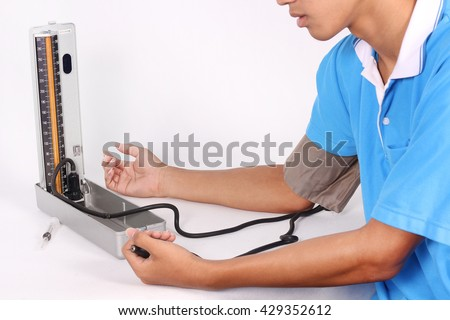 sphygmomanometer us measure blood pressure on doctors and nurses in the treatment in the hospital. - stock photo