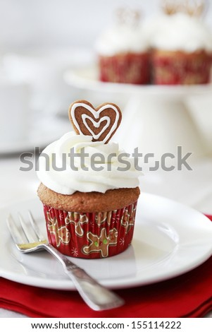 Spice cupcake with cream cheese frosting decorated for Christmas. - stock photo