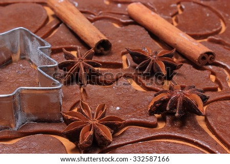 Spice for baking and cookie cutters in shape of christmas tree on dough for Christmas cookies and gingerbread, concept of baking - stock photo