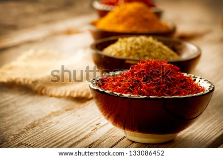 Spice. Various Spices over Wooden Background. Saffron, turmeric, curry - stock photo