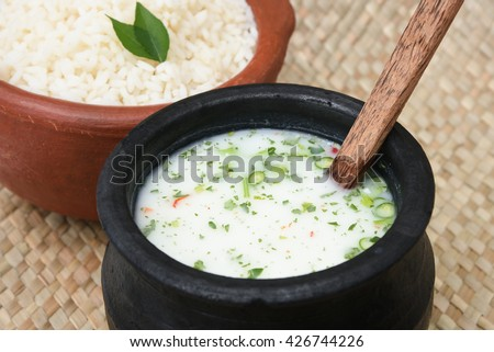 Spiced buttermilk / chaas / chaach / moru / sambharam / curd, cool refreshing drink for hot summer in a clay pot with white / parboiled / basmati rice, Kerala, India. Flavoured Indian buttermilk.