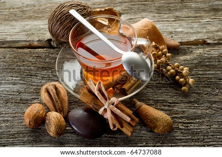 spiced tea over wood background - stock photo