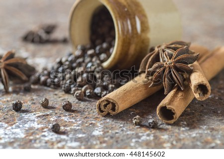 Spices and herbs. Food and cuisine ingredients. Cinnamon sticks, anise stars, black peppercorns on textured background   - stock photo