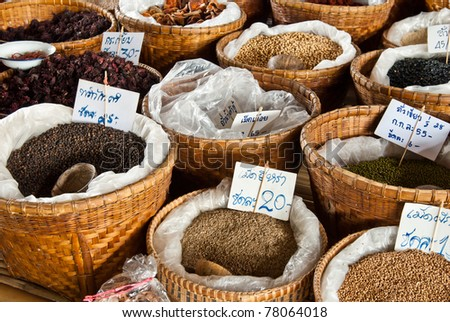 Spices and herbs in bamboo basket at market - stock photo