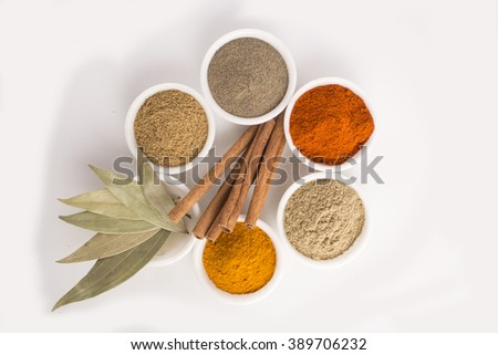 Spices and herbs in bowl with cinnamon - stock photo