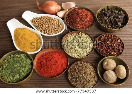 Spices and herbs in metal  bowls and spoons. Food and cuisine ingredients.