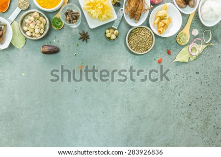 Spices and herbs in metal bowls. Food and cuisine ingredients. Colorful natural additives for decorate and design project. - stock photo
