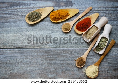 Spices and herbs in wooden and glass bowls and spoons. Food and cuisine ingredients - stock photo