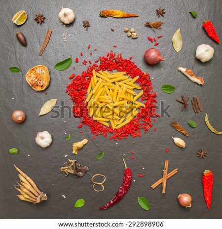 Spices and herbs on stone background, Top view indian mix spices, vegetable and herbs difference ware on stone background with copy space for design spices, vegetables, herbs or foods content. - stock photo