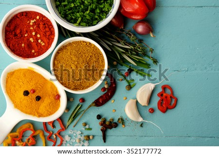 Spices and herbs over blue background.  Food and cuisine ingredients. - stock photo