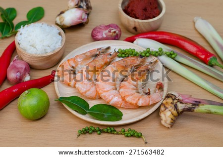 spices and prawn on wooden background