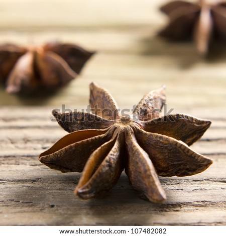Spices. Anise stars on the vintage wooden surface - stock photo