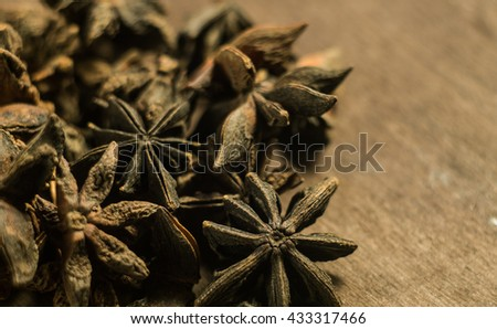 Spices. Anise stars photo. Intentionally blurred lens focus effect. Color toning. Closeup. - stock photo
