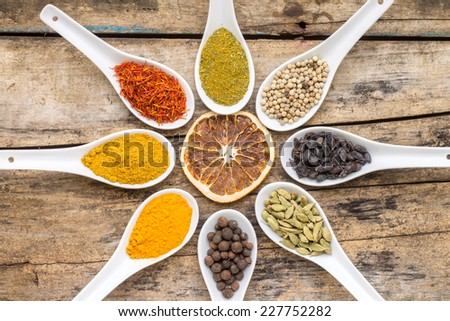 Spices background.  Diversity of condiments on wooden table. Top View - stock photo