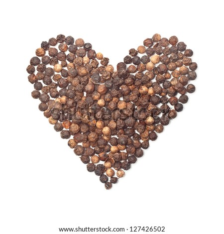 spices black pepper heart shape on white background