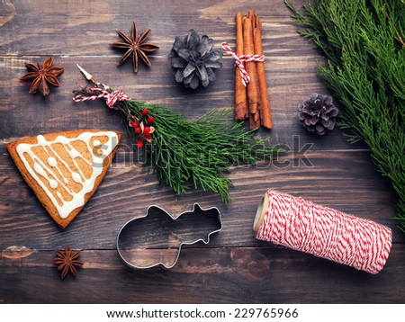 Spices, cones and gingerbread on the wooden table. Christmas still life. Top view. Toned photo - stock photo