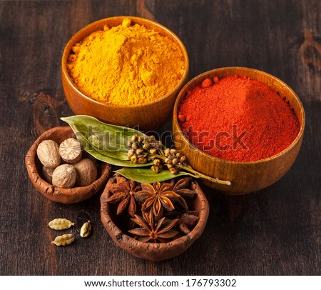 Spices Curry, paprika, nutmeg, cardamom, bay leaf. Spice over Wood. - stock photo
