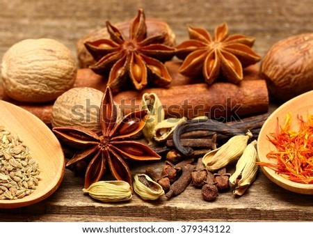 Spices for desserts on the wooden table - stock photo