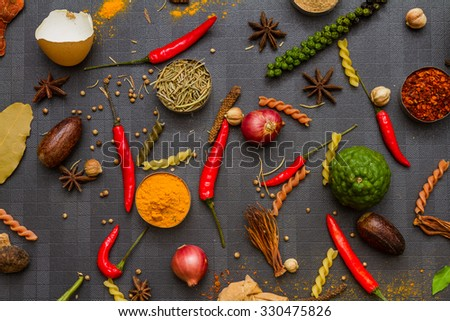 Spices for herb and cooking on black background. - stock photo