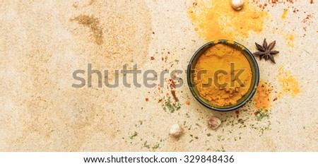 Spices for herb and cooking on brown background. - stock photo