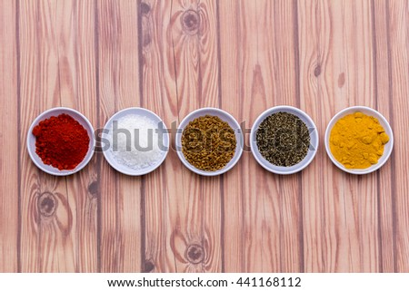 Spices for herb and cooking,Top view spices on wood background,spices content,Various kinds of spices on wood background. - stock photo