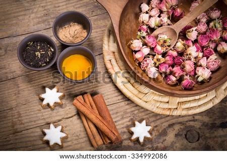 Spices for masala tea on dark wooden table