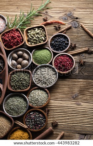 Spices. Herbs and spices selection in old metal and wooden bowls over wooden background. Rosemary, ginger and chili pepper. - stock photo