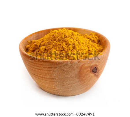 spices in a wooden platter isolated on a white background - stock photo