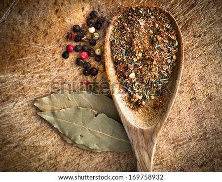 spices in a wooden spoon on a cutting board