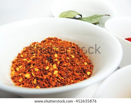 Spices in bowls, isolated on white        - stock photo