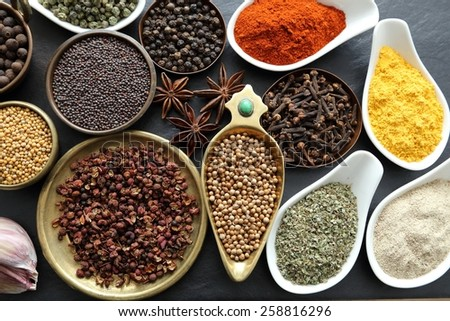 Spices in ceramic containers and metal bowls. Food and cuisine ingradients. - stock photo